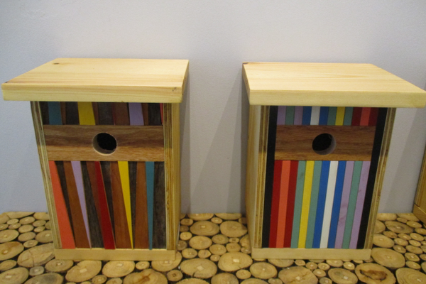 Handmade birdhouses are featured as part of the exhibit.