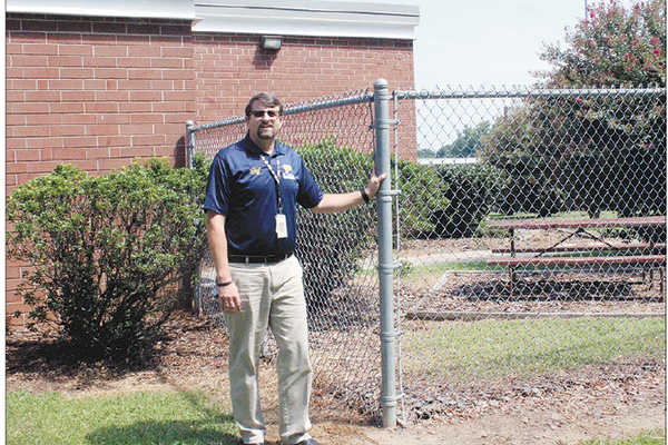 One of the schools' bigger safety precautions is having this heavy-duty, chain link fence placed, surrounding the school and its play areas.