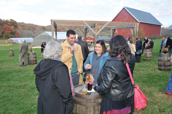 Guests enjoy appetizers and cocktails at a Dinner on the Farm event at Primrose Valley Farm, in New Glarus, Wisconsin.