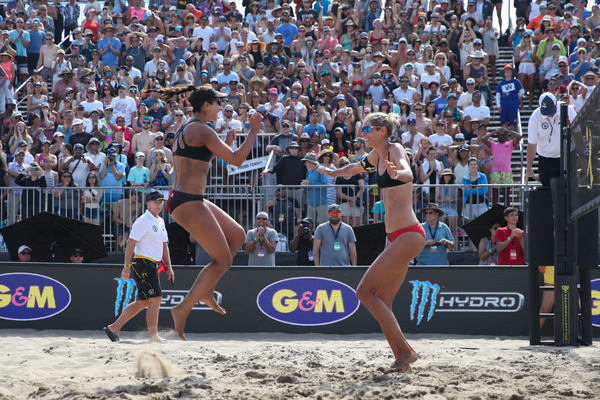 The team of Melissa Humana-Paredes and Sarah Pavan celebrates victory at the 2019 AVP Manhattan Beach Open. Photo credit: Mpu Dinani/AVP
