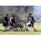 Reenactors fire a cannon at a past Chadds Ford Days event