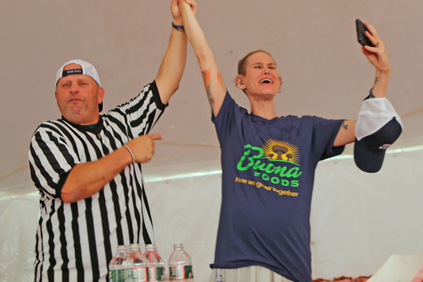 Molly Schuyler is named the winner of the fried mushroom eating contest. She consumed 9.2 pounds in eight minutes.