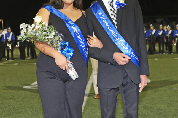 Kennett Royalty Queen Milady Lagunas and King Tejis Ranganath greet the crowd at halftime.