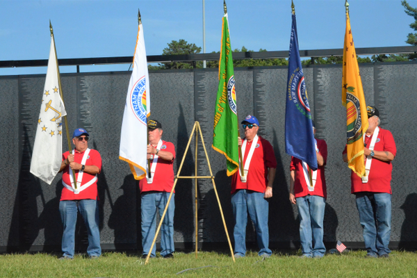 Local veterans display the Vietnam Veterans Association flags as part of the presentation of the colors