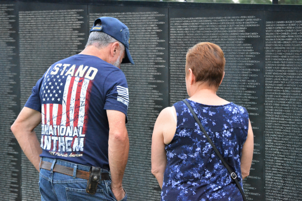 James Felice, US Airforce, of Woonsocket, RI , and his wife Louise look at the wall.