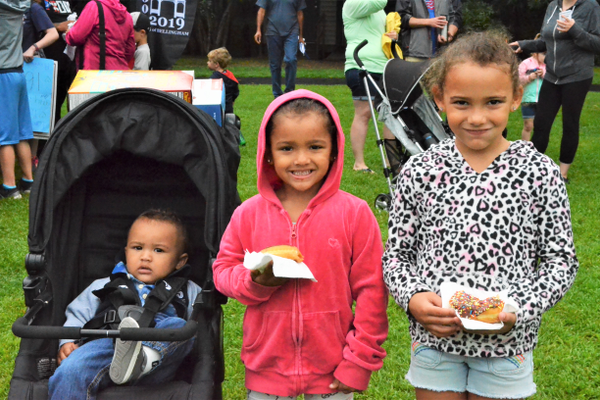 Marcus Boyer (10 months), Emma Boyer (Age 5) and Addison Boyer (Age 6) enjoy some Dunkin Donuts at the Zip Trip (photo by Jen Russo)