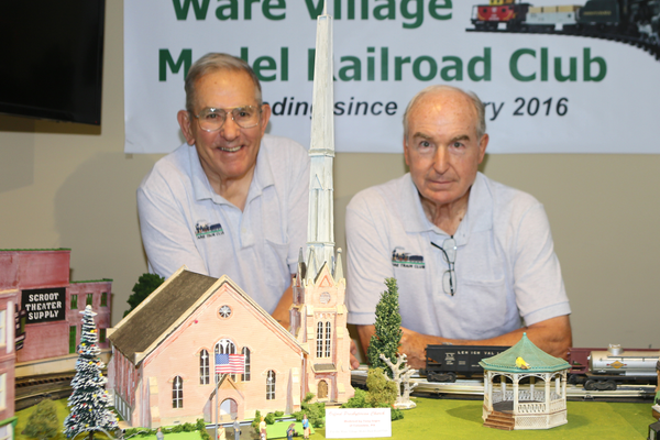 From left, Dick Fowler and Fred Crotchfelt flank the spire of the Oxford Presbyterian Church built in miniature on the platform.
