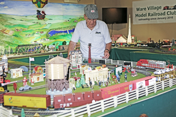 Yard master Bob Undercuffler oversees the large table that houses the O-gauge trains.