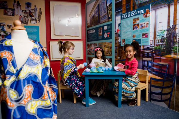 kids in teahouse setting at Zanzibar exhibit