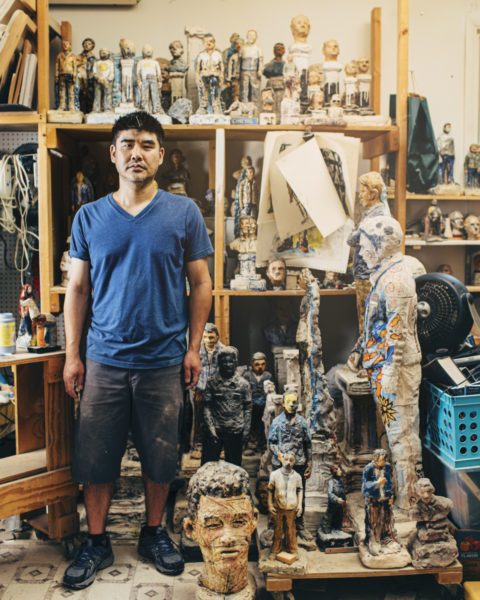 Richard Chung standing in is his studio
