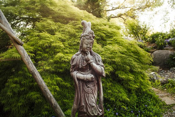 statue in Bing Chen's home garden