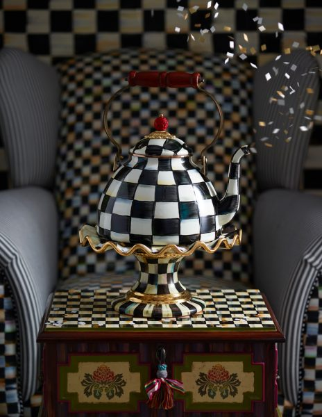 Artistic checkered teapot on decorative table