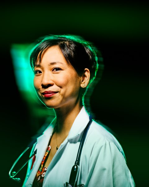 Head shot Dr. Lydia Kang in lab coat with stethoscope