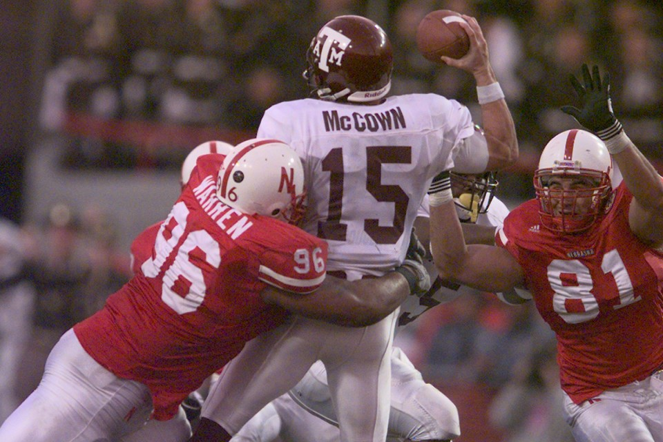Warren (96) delivers a bone-crushing hit back in his playing days for Big Red.