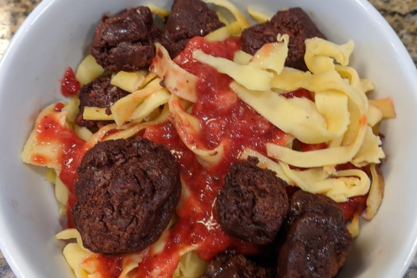 Dessert Imposter Spaghetti and Meatballs: Brownie meatballs, crepe noodles, and strawberry coulis.
