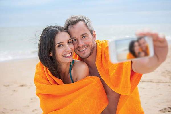 Couple Taking Selfie at Beach