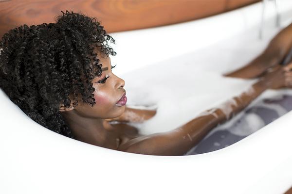 Woman lying in healing bath water