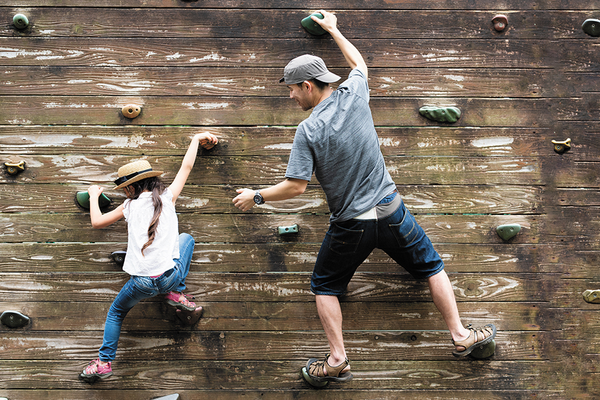 Parent Teaching Child Resilience Through Rock Climbling
