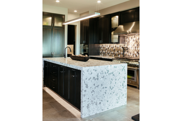 marble covered island in kitchen