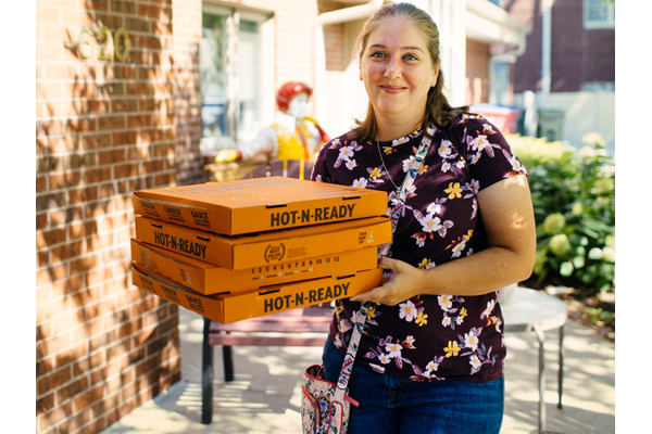 Tara Maco-Guillen with pizza boxes