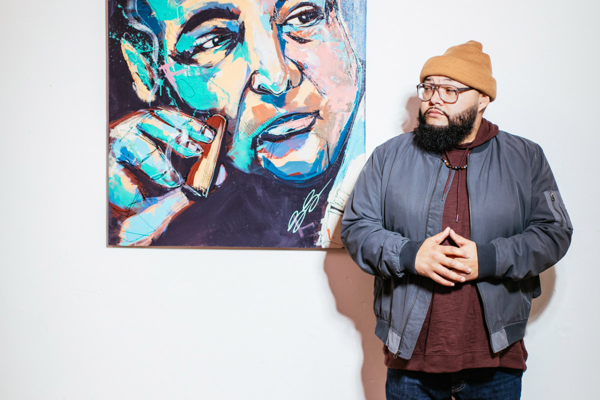 Dany Reyes with his painting