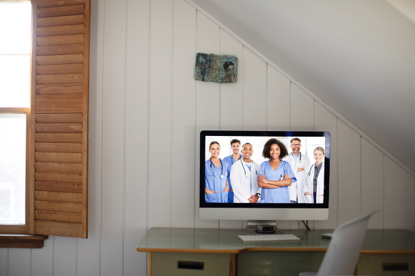 doctors on desktop screen, on desk
