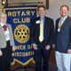 Rotary Member Mickale Carter, Deputy Secretary of the Wisconsin Department of Tourism, Dave Fantle, and Chamber Director Phil Fritsche