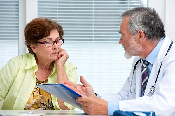 Stock photo, doctor explaining chart to older woman