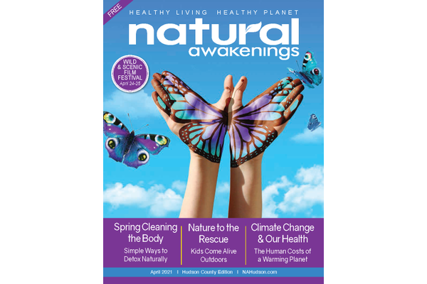 April 2021 Cover of Natural Awakenings Hudson County with a persons hands painted like a blue and purple butterfly with a couple of other butterflies flying around it and clouds in teh background