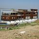 A unique, teak 34-passenger riverboat.