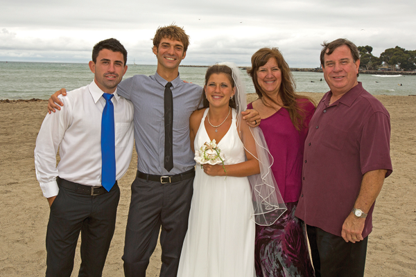 At the wedding of her daughter, Stephanie, center, Peggy poses with her son, Jeffery, far left, son-in-law Alessio and husband, Chris.