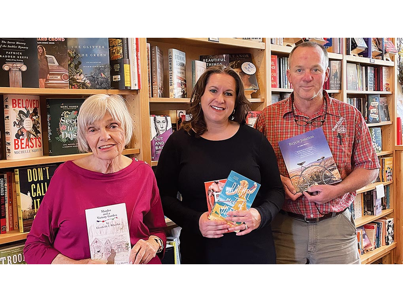 Chris Brown, Christina Hovland and Elizabeth Wheeler hold books they published during the pandemic.