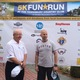 Race organizer Jerry Selissen and major sponsor Marc Ginsburg pose in front of the sponsors board at the Tewksbury Memorial Day 5K Fun Run. The event raised more than $40,000 for the Wonded Warriors Project.