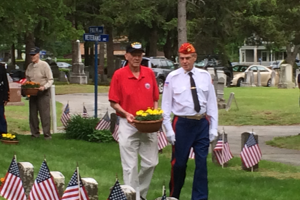 Flowers are laid at the Tewksbury Memorial Day Ceremony.