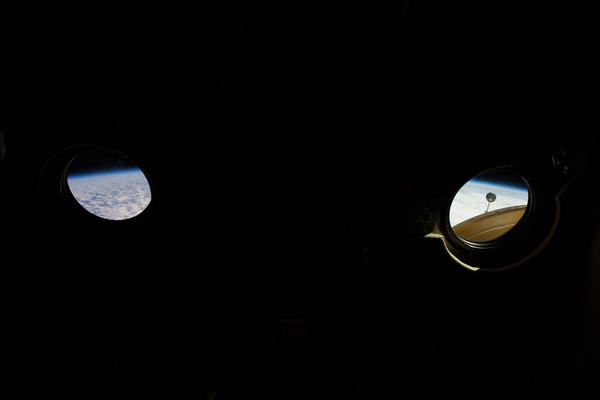 Earth and the Pirs Docking Compartment seen from the Zvezda Service Module. (#23)