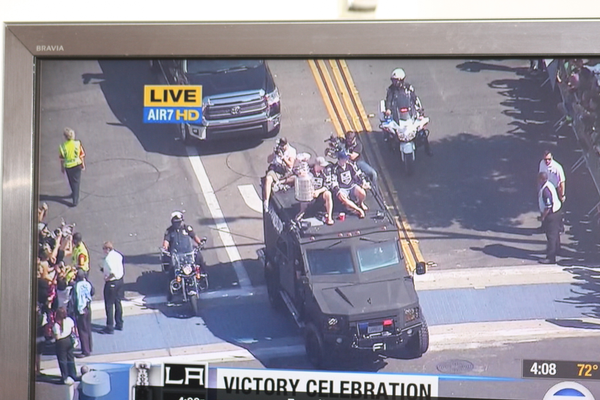 A news chopper overhead captured the parade for TV news.