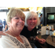 Manhattan Beach residents Kathleen Brunick and Barbara Casady enjoy drinks and seafood at the bar after the LA Kings Parade June 19, 2014.
