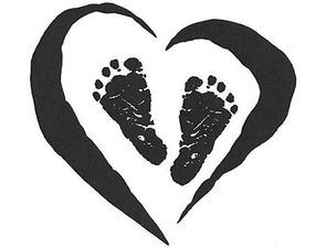Medium footprints in heart tattoo