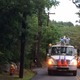 A National Grid crew works to repair damaged power lines on Pine Street after the storm Thursday.