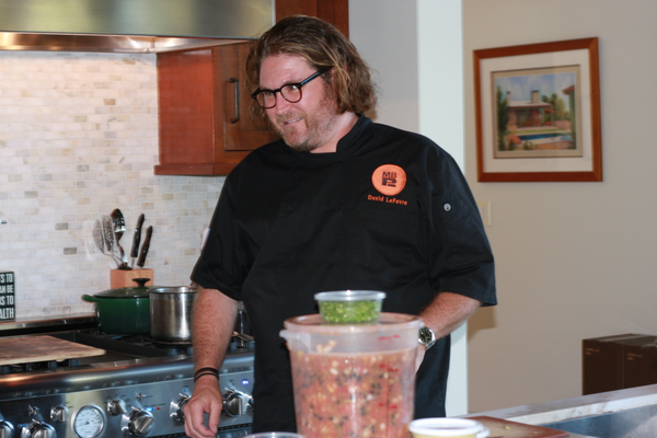 Manhattan Beach Post and Fishing With Dynamite Chef David LeFevre preps for his live cooking demonstration.