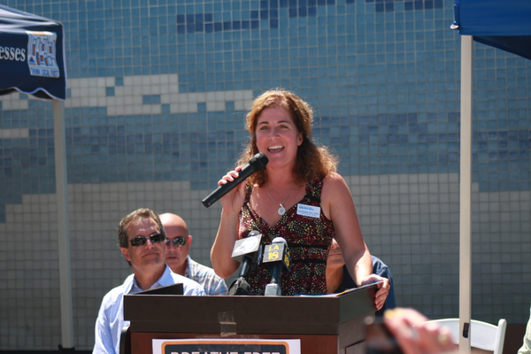 Dr. Lisa Santora, chief medical officer of the Beach Cities Health District, addresses the crowd.