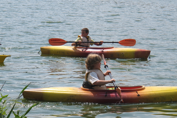 Eric and Jonah paddle on Long Pond during Adventure Kids Kayak Camp.