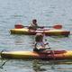 Eric and Jonah paddle on Long Pond during Adventure Kids Kayak Camp.