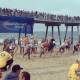 L.A. County lifeguards break into a sprint at the start of the lifeguard competition at the International Surf Festival