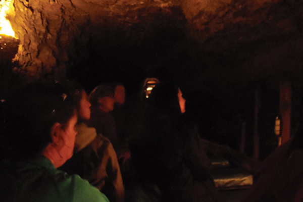 Traveling through a 1,600-ft. underground water tunnel on the Lockport Cave & Underground Boat Ride.