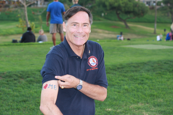 Mayor Wayne Powell shows off his signature I Heart MB tattoo.