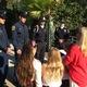 Paramedics and color guard members get a briefing from Linda Geoghegan, Robinson PTSA VP for school spirit