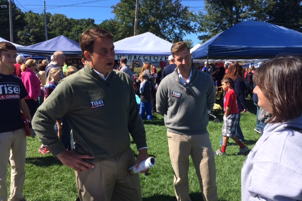 Congressional Candidate Richard Tisei talks to a voter at the Fall Harvest Fair in Tewksbury.